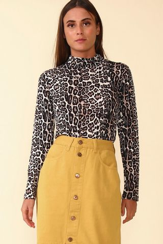 02011873_1015_1-BLUSA-TURTLENECK-ANIMAL-PRINT
