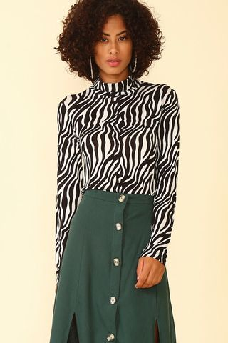 02011873_1002_1-BLUSA-TURTLENECK-ANIMAL-PRINT